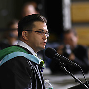 Thomas McKean High School Principal Principal Brain Mattix addresses students and family during McKean 49th commencement exercises Saturday, June 06, 2015, at The Bob Carpenter Sports Convocation Center in Newark, Delaware.