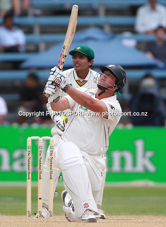 Jesse Ryder hits a 6 as Pakistan wicketkeeper Adan Akmal looks on during Day 4 of the 2nd test match.  New Zealand Black Caps v Pakistan, Test Match Cricket. Basin Reserve, Wellington, New Zealand. Tuesday 18 January 2011. Photo: Andrew Cornaga/photosport.co.nz