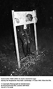 Gatecrasher, Rob Collins in stocks covered in eggs during the Magdalene May Ball. Cambridge. 15 June 1983. Film 83415f6.<br />