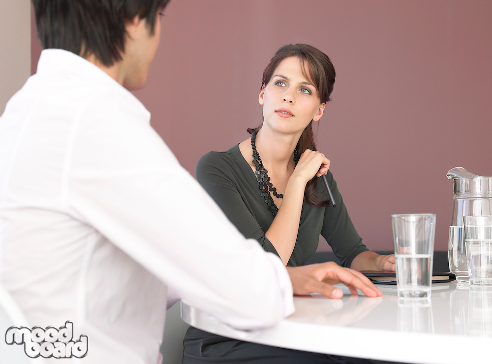 Business man and woman having meeting