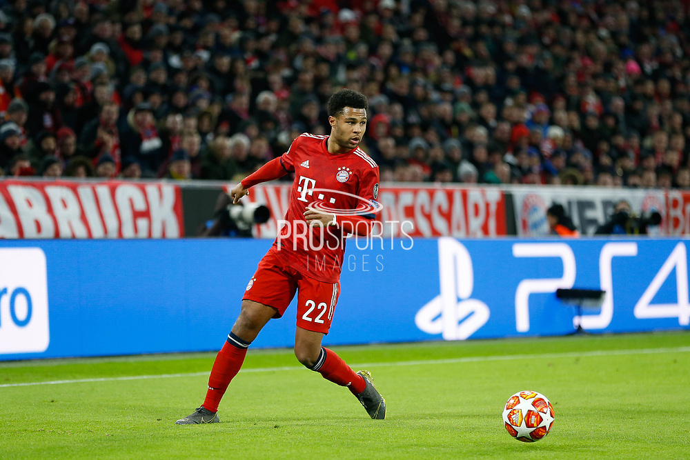 Bayern Munich midfielder Serge Gnabry (22) looks to put in a cross during the Champions League match between Bayern Munich and Liverpool at the Allianz Arena, Munich, Germany, on 13 March 2019.