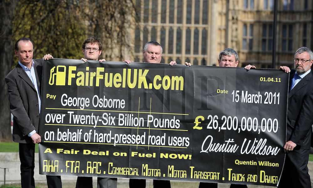 ©London News pictures. 10/03/11.Quentin Willson (L) leads a Fuel Tax protest on College Green outside Parliament, holding a giant cheque to represent the £26 billion Britons pay in fuel duty each year, the campaign was organised by www.fairfueluk.com. Picture Credit should read Stephen Simpson/LNP