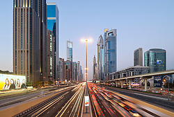 Dusk view of traffic and skyscrapers on Sheikh Zayed Road in Dubai United Arab Emirates