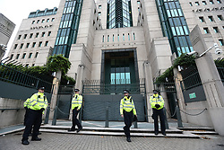 © Licensed to London News Pictures. 15/10/2019. London, UK. Police guard MI6. Activists continue to occupy roads around Westminster and the City for the 9th day. Photo credit: Alex Lentati/LNP