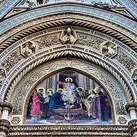 """Duomo Central Tympanum Mosaic in Florence, Italy<br /> A tympanum is a semi-circular wall above an entrance and an archivolt are the ornamental moldings that follow the arch.  Few are more gorgeous than this one that surrounds a mosaic called """"Christ enthroned with Mary and John the Baptist.""""  All three mosaics on the Cathedral of Florence's façade were designed by Nicoolò Barabino.  They welcome you to the artist treasures inside the Duomo."""