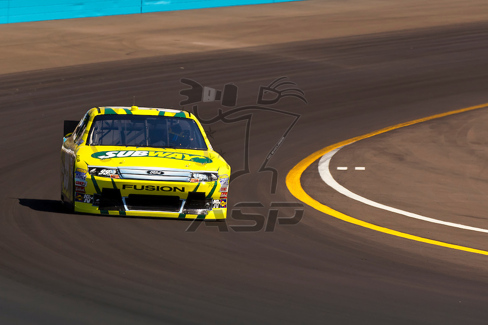 AVONDALE, AZ - MAR 03, 2012:  Carl Edwards (99) brings his NASCAR Sprint Cup car through turn 4 during qualifying for the Subway Fresh Fit 500 race at the Phoenix International Raceway in Avondale, AZ.
