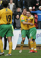 Huddersfield - Saturday, March 13th, 2010: Stephen Elliott of Norwich City celebrates scoring the third goal against Huddersfield Town with Grant Holt during the Coca Cola League One match at the Galpharm Stadium, Huddersfield. (Pic by Michael Sedgwick/Focus Images)