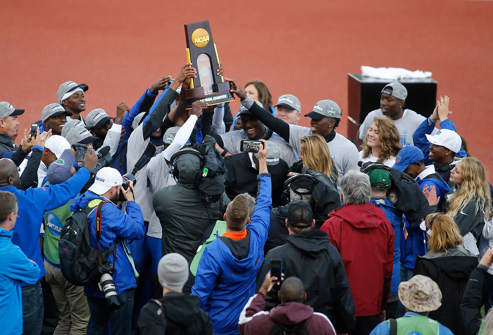 The Florida Gators hold the National Championship trophy high after winning the men's team title on the third day of the NCAA outdoor college track and field championships in Eugene, Ore., Friday, June 9, 2017. (AP Photo/Timothy J. Gonzalez)