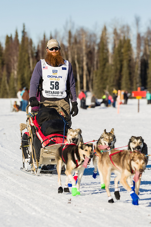Musher Trent Herbst competing in the 44th Iditarod Trail Sled Dog Race on Long Lake after leaving the restart on Willow Lake in Southcentral Alaska.  Afternoon. Winter.