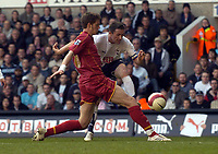 Photo: Olly Greenwood.<br />Tottenham Hotspur v Reading. The Barclays Premiership. 01/04/2007. Spurs Robbie Keane shoots at goal past Reading's Greg Halford