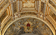 (Detail)The ceiling of the Scala D'oro (Golden Staircase) from the Doge's Palace in Venice, Italy. The palace was the residence of the Doge of Venice, the supreme authority of the Republic of Venice. Its two most visible façades look towards the Venetian Lagoon and St. Mark's Square, or rather the Piazzetta. The use of arcading in the lower stories produces an interesting 'gravity-defying' effect. There is also effective use of colour contrasts. largely constructed from 1309 to 1424, designed perhaps by Filippo Calendario. It replaced earlier fortified buildings of which relatively little is known. Giovanni and Bartolomeo Bon created the Porta della Carta in 1442, a monumental late-gothic gate on the Piazzetta side of the palace. This gate leads to a central courtyard. The palace was badly damaged by a fire on December 20, 1577.