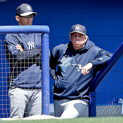 Mar 14, 2013; Dunedin, FL, USA; New York Yankees manager Joe Girardi (28) and pitching coach Larry Rothschild (58)  look on from the dugout during the bottom of the second inning of a spring training game against the Toronto Blue Jays at Florida Auto Exchange Park. Mandatory Credit: Derick E. Hingle-USA TODAY Sports
