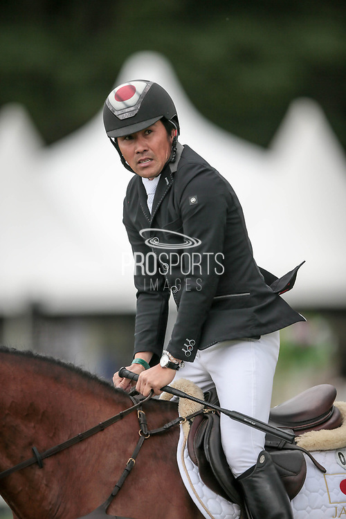 Overall Equitrek CCI*** winner CALLE 44 ridden by Yoshiaki Oiwa (JPN) looks at the scoreboard having completed his round during the final show jumping round on day four of Bramham International Horse Trials 2017 at  at Bramham Park, Bramham, United Kingdom on 11 June 2017. Photo by Mark P Doherty.
