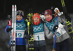 PYEONGCHANG, Feb. 12, 2018  Champion Laura Dahlmeier (C) from Germany, second-placed Anastasiya Kuzmina (R) from Slovakia and third-placed Anais Bescond from France celebrate during the venue ceremony of women's 10km pursuit event of biathlon at the 2018 PyeongChang Winter Olympic Games at Alpensia Biathlon Centre in PyeongChang, South Korea, on Feb. 12, 2018. Laura Dahlmeier claimed champion in a time of 30:35.3. (Credit Image: © Wang Haofei/Xinhua via ZUMA Wire)