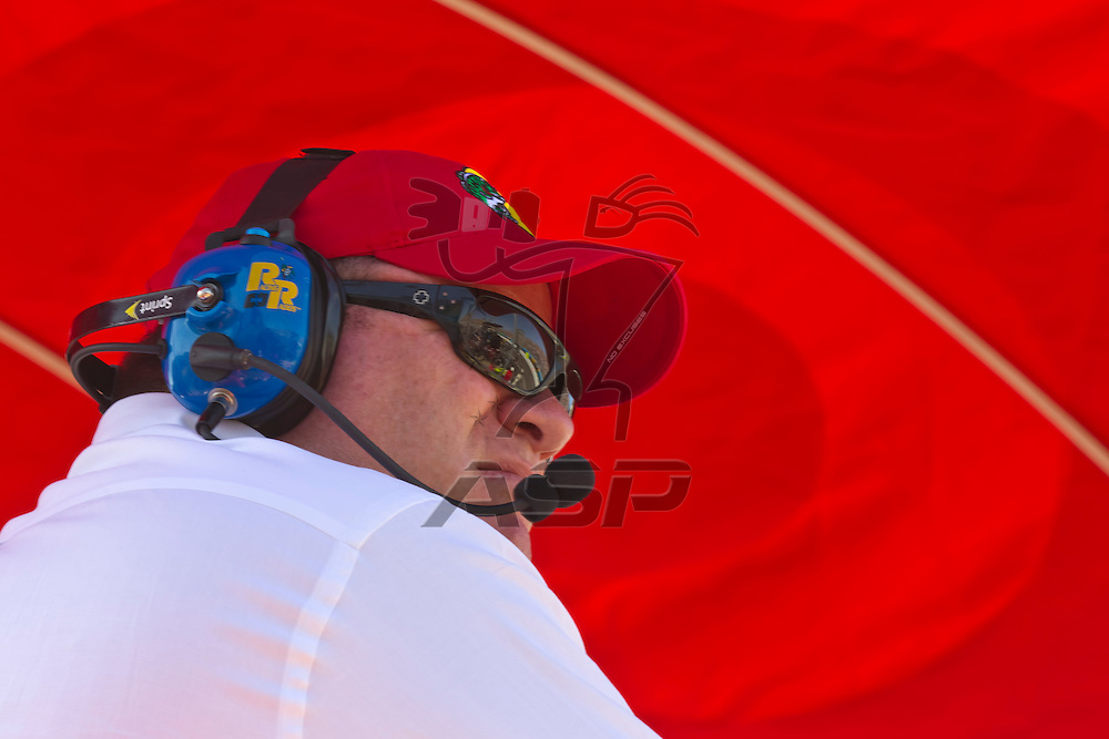 AVONDALE, AZ - MAR 04, 2012:  Car owner, Chip Ganassi, watches his teams during the Subway Fresh Fit 500 race at the Phoenix International Raceway in Avondale, AZ.
