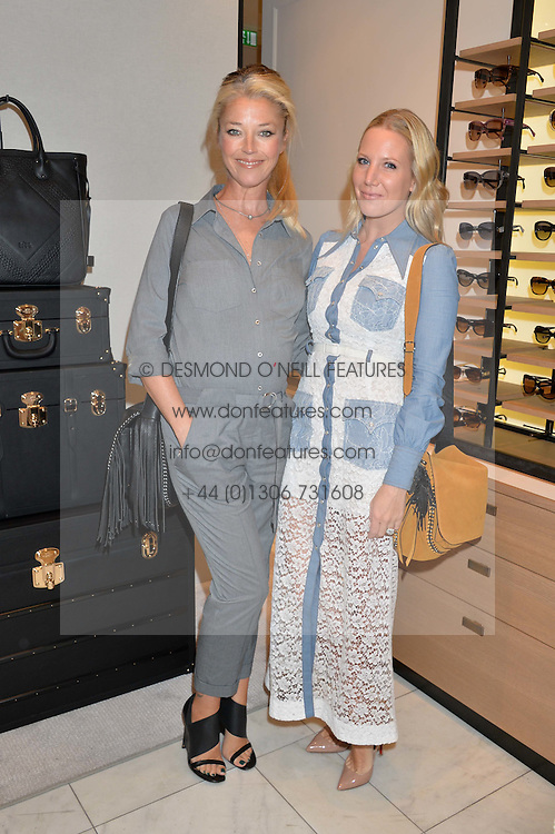 Left to right, TAMARA BECKWITH and ALICE NAYLOR-LEYLAND at a lunch hosted by Alice Naylor-Leyland and Tamara Beckwith in celebration of the Coach 2015 collection held at Coach, New Bond Street, London on 18th September 2014.