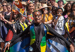 © Licensed to London News Pictures.  07/07/2018; Bristol, UK. Bristol's St Pauls Carnival 50th anniversary. Carnival procession through the streets of St Pauls with many Bristol schools taking part, which has long been a multi-cultural inner city area of Bristol with a a strong Afro-Caribbean community since the Windrush generation. The carnival has not been held for several years due to funding issues but has now secured funding for this year's carnival and beyond. Photo credit: Simon Chapman/LNP