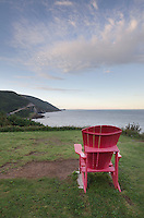 Red adirondack chair at viewpoint, Cape Breton Highlands National Park, Cape Breton Island Nova Scotia