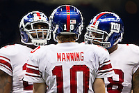 28 November 2011: Quarterback (10) Eli Manning of the New York Giants huddles up his team against the New Orleans Saints during the first half of the Saints 49-24 victory over the Giants at the Mercedes-Benz Superdome in New Orleans, LA.