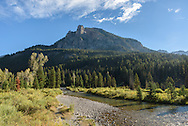 The Open Door towers above Granite Creek shortly after sunrise in the Gros Ventre Mountains.