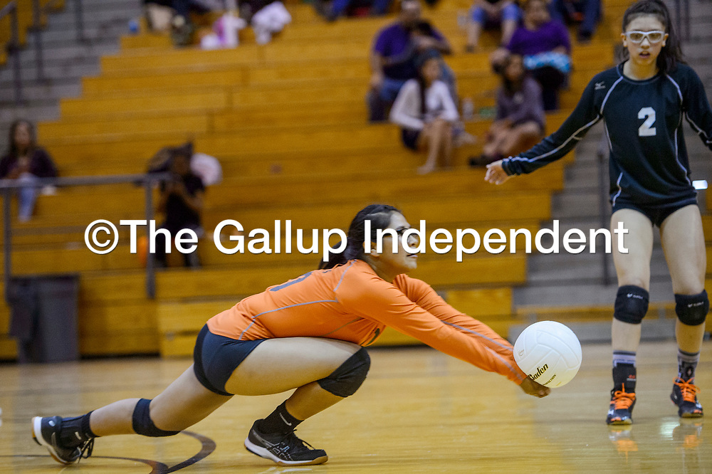 Gallup Bengal Shaylana Thomas (10) dives to save a serve from the Kirtland Central Broncos Thursday at Gallup High School.