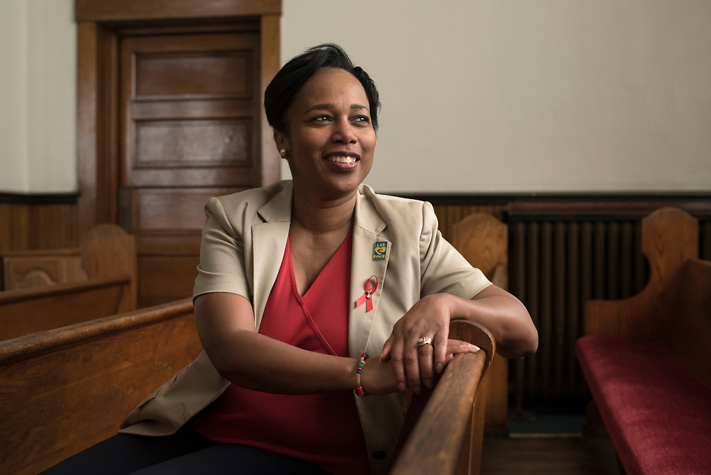 Trisha Gadson , Executive Director of FACE Macedonia, at Macedonia Baptist Church in the Hill District.<br /> She always wear a red ribbon to raise awarness of AIDS and HIV. The angle pin is in momeory of her mother whose death inspired Gadson to help people living with AIDS.