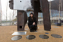 © Licensed to London News Pictures. 17/03/2015. London, UK. Artist, Miya Ando looks at her steel sculpture crafted out of the 9/11 Twin Towers' steel wreckage at the Queen Elizabeth Olympic Park in Stratford today. The artwork by American artist, Miya Ando commemorates the 10th anniversary of the 9/11 attacks and stands at 28 feet tall and weighs over 4 tons. Photo credit : Vickie Flores/LNP