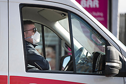 © Licensed to London News Pictures. 12/03/2020. London, UK. An ambulance worker wearing a medical face mask while working in North London. New cases of the COVID-19 strain of Coronavirus are being reported daily as the government outlines it's plans for controlling the outbreak. Photo credit: Ben Cawthra/LNP