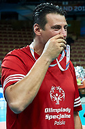 """Katowice, Poland - 2017 September 01: SO Ambassador Vladimir """"Vanja"""" Grbic a former Serbian volleyball player (he won a gold medal in the 2000 Summer Olympics and a bronze medal in 1996 at Atlanta) kisses his Special Olympics medal after All Stars Game while Opening Ceremony during European Unified Volleyball Tournament 2017 at Spodek Hall on September 01, 2017 in Katowice, Poland.<br /> <br /> Adam Nurkiewicz declares that he has no rights to the image of people at the photographs of his authorship.<br /> <br /> Picture also available in RAW (NEF) or TIFF format on special request.<br /> <br /> Any editorial, commercial or promotional use requires written permission from the author of image.<br /> <br /> Image can be used in the press when the method of use and the signature does not hurt people on the picture.<br /> <br /> Mandatory credit:<br /> Photo by © Adam Nurkiewicz / Mediasport"""