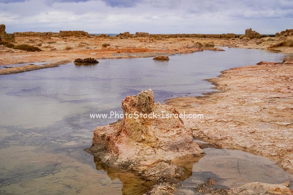Rocky beach on the Greek Island of Crete with dramatic sky