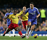 Photo: Lee Earle.<br /> Chelsea v Watford. The Barclays Premiership. 11/11/2006. Chelsea's Frank Lampard (R) battles with Lloyd Doyley.