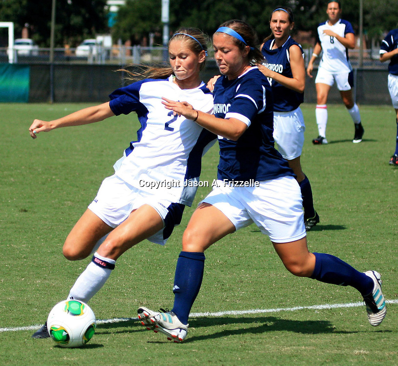 UNCW's Katie O'Donnell battles for the ball with Longwood's Chelsea Walter.