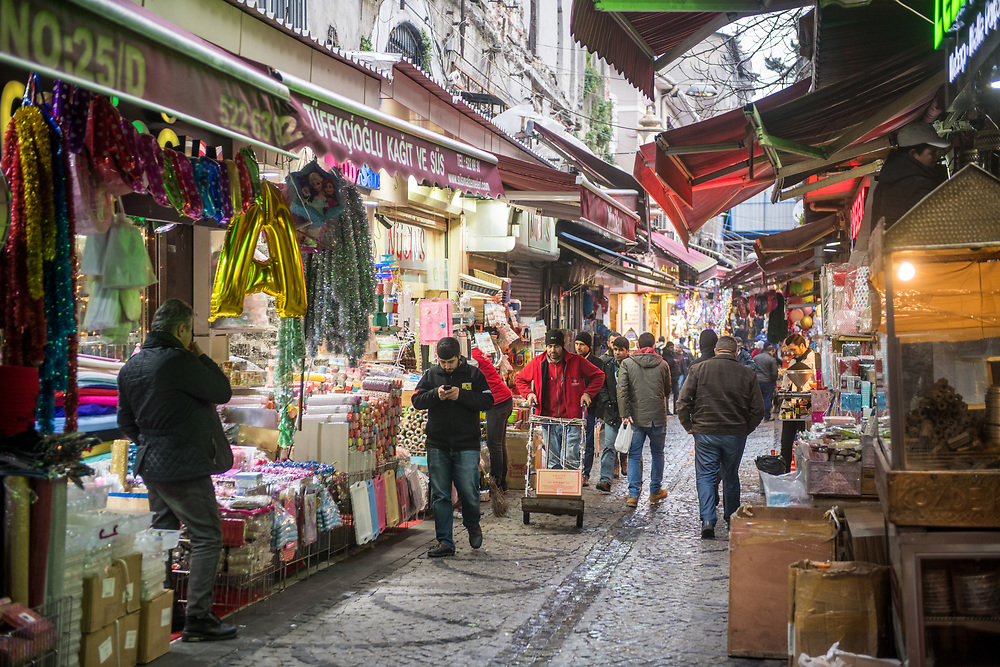 A busy narrow street with outdoor marketplace selling various goods, Istanbul Spice bazaar