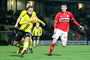 Marcus Myers-Harness of Burton Albion (16) clears from Tyrone O'Neill of Middlesbrough (45) during the EFL Trophy group stage match between Burton Albion and U21 Middlesbrough at the Pirelli Stadium, Burton upon Trent, England on 7 November 2018.