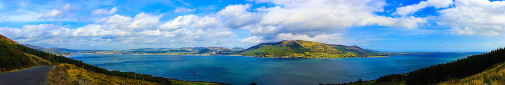 View overlooking Carlingford Lough from Slieve Foy Forest Park including, from left, the North-Western tip of the Cooley Mountains, Warrenpoint, Rostrevor, the Mourne Mountains, Killowen, Greencastle and the Mouth of Carlingford Lough. Image composed of 15 photos at 35mm.<br />