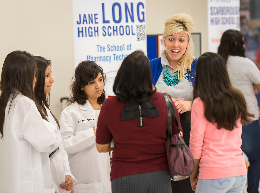 Jane Long High School magnet coordinator Keri Whittpenn, right, talks with potential students during a School Choice Fair at Northwest Mall, April, 26, 2014.