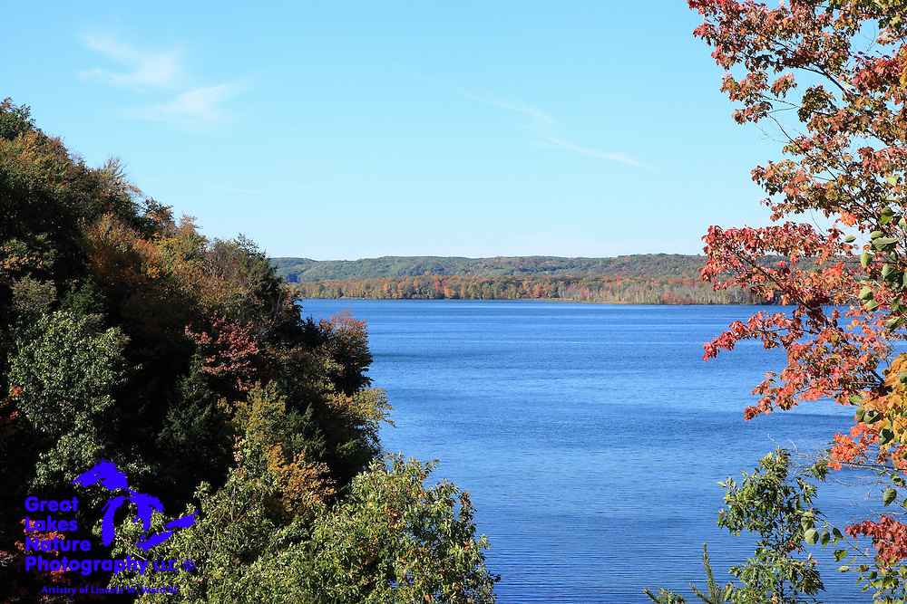 Hodenpyl Pond (the backwaters of the Hodenpyl hydroelectric dam) and its surroundings are stunning in the autumn. This view can be enjoyed just south of the town of Mesick, Michigan on highway M-37.