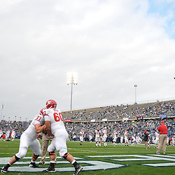 Oct 31, 2009; East Hartford, CT, USA; Rutgers offensive linemen Art Forst (77) and Caleb Ruch (60) warm up for Big East NCAA football action between Rutgers and Connecticut at Rentschler Field.