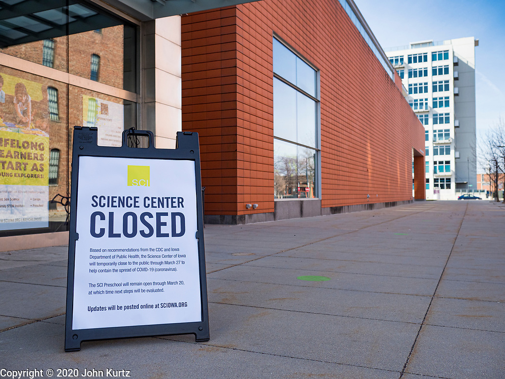 """17 MARCH 2020 - DES MOINES, IOWA:  The Science Center of Iowa, in Des Moines, is closed because of the Coronavirus outbreak. Sunday night, the Governor announced that the state health department had recorded """"community spread"""" in Des Moines. Tuesday, the Governor ordered all restaurants and bars to close or go to take out only. The Iowa Department of Public Health has urged all public buildings, like libraries and schools, to close, and all schools in Iowa are closed for at least 30 days.    PHOTO BY JACK KURTZ"""