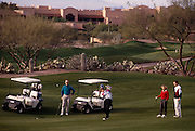 Foursome golfing on fairway Canyon hole#1, Westin La Paloma. ©1993 Edward McCain. All rights reserved. McCain Photography, McCain Creative.