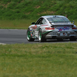 May 23, 2009; Lakeville, CT, USA; The Racers Group Porsche driven by Duncan Ende and Spencer Pumpelly qualifies for the Grand-Am Koni Sports Car Challenge series Grand Sport competition during the Memorial Day Road Racing Classic weekend at Lime Rock Park.
