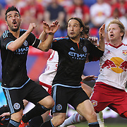 David Villa, (left), Ned Grabavoy, (center), NYCFC, and  Dax McCarty, New York Red Bulls,  in action during the New York Red Bulls Vs NYCFC, MLS regular season match at Red Bull Arena, Harrison, New Jersey. USA. 10th May 2015. Photo Tim Clayton