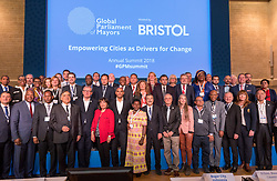 © Licensed to London News Pictures. 22/10/2018. Bristol, UK. Global Parliament of Mayors Annual Summit, 21-23 October 2018, at Bristol City Hall. Group picture of Global Mayors together, with MARVIN REES, Mayor of Bristol, UK, centre. The Global Parliament of Mayors 2018 is the biggest and most ambitious Annual Summit to date. GPM Bristol 2018 will host up to 100 global mayors for an action-focused summit that addresses some of the biggest challenges facing today's world cities. GPM Bristol 2018's theme, Empowering Cities as Drivers of Change, will focus minds on global governance and the urgent need for the influence, expertise and leadership of cities to be felt as international policy is shaped. GPM Bristol 2018 will provide mayoral delegates with a global network of connections and a space to develop the collective city voice necessary to drive positive change. The programme will engage participants in decision-making, with panels, debate and voting on priority issues including migration and inclusion, urban security and health, and is a unique chance to influence decisions on the most pressing issues of our time. Photo credit: Simon Chapman/LNP