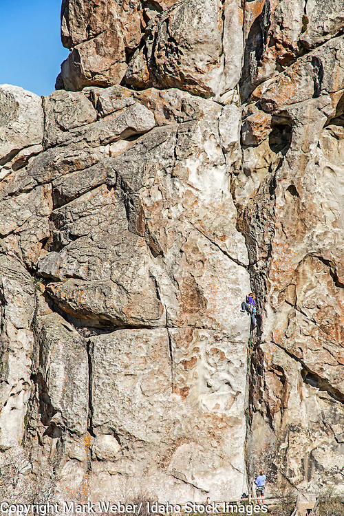 Jocelynn Smith rock climbing a route called Private Idaho which is rated 5,9 and located on Bath Rock at the City Of Rocks National Reserve near the city of Almo in southern Idaho