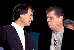 Steve Jobs speaks with Then Apple CEO Gil Amelio on stage  at  Macworld 1997 in San Francisco, California.