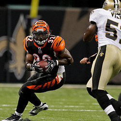 2009 August 14: Cincinnati Bengals running back Cedric Benson (32) runs as New Orleans Saints linebacker Jonathan Vilma (51) pursues on the play during a preseason opener between the Cincinnati Bengals and the New Orleans Saints at the Louisiana Superdome in New Orleans, Louisiana.