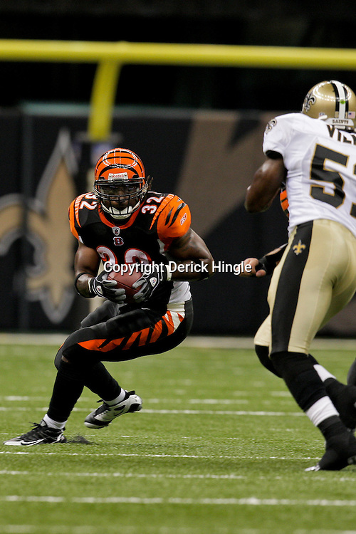 2009 August 14: Cincinnati Bengals running back Cedric Benson (32) runs as New Orleans Saints linebacker Jonathan Vilma (51) pursues on the play during a preseason opener between the Cincinnati Bengals and the New Orleans Saints at the Louisiana Superdome in New Orleans, Louisiana.