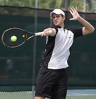 Ricardo Conte returns the ball during a training session at Pembroke Lakes Tennis Club on Tuesday June 16, 2009  Staff photo/Cristobal Herrera....