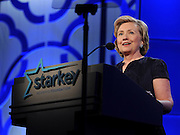 "Former U.S. Secretary of State Hillary Rodham Clinton speaks at the Starkey Hearing Foundation's ""So the World May Hear"" Awards Gala on Sunday, July 20, 2014 in St. Paul, Minn. The foundation is a member of the Clinton Global Initiative and gives away more than 100,000 hearing aids in the U.S. and around the world annually. (Photo by Diane Bondareff/Invision for Starkey Hearing Foundation/AP Images)"