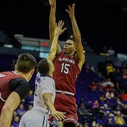 Feb 1, 2017; Baton Rouge, LA, USA; South Carolina Gamecocks guard PJ Dozier (15) shoots over LSU Tigers guard Brandon Sampson (0) during the first half of a game at the Pete Maravich Assembly Center. Mandatory Credit: Derick E. Hingle-USA TODAY Sports